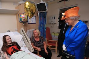 Mandatory Credit: Photo by REX/Shutterstock (8841387n) Queen Elizabeth II speaks to Millie Robson, 15, from Co Durham, and her mother, Marie, during a visit to the Royal Manchester Children's Hospital to meet victims of the terror attack in the city earlier this week and to thank members of staff who treated them. Queen Elizabeth II visits Royal Manchester Children's Hospital, UK - 25 May 2017